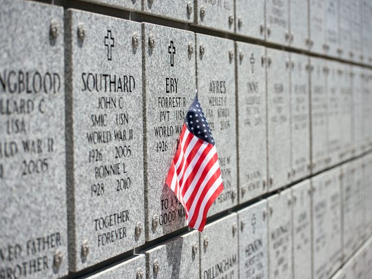 A flag is pinned to a memorial wall at the Northern Nevada Veterans Memorial Cemetery in May 2017.