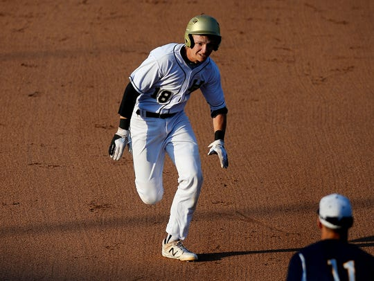 Holt's Spencer Baldwin makes his way to third base