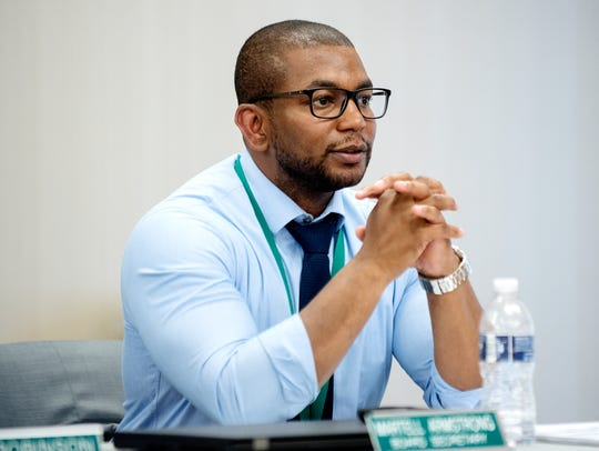 Lansing Housing Commission Executive Director Martell Armstrong listens to public comment during a board meeting on Wednesday, June 27, 2018, in the front office of the LaRoy Froh housing complex in Lansing.