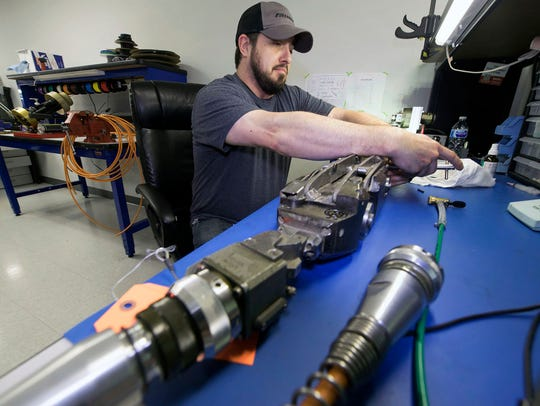 Darin Bartron works at Rausch Electronics on Wednesday,
