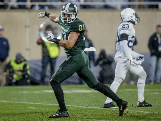 Michigan State's Matt Sokol celebrates tackling Penn
