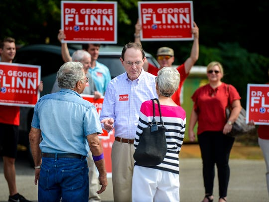 US Congressional republican candidate Dr. George Flinn talks with Madison County voters before they head to the cast their ballots in the 2018 primary election early voting, Thursday, July 26.