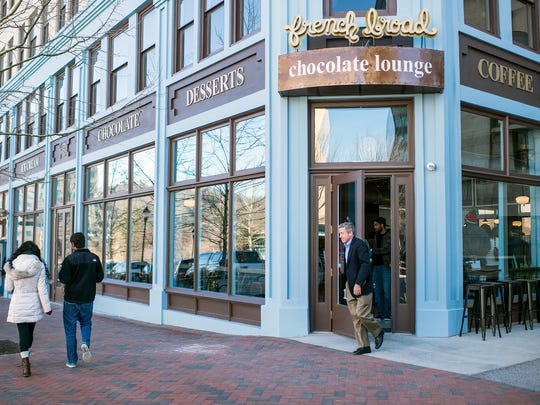 Asheville police arrested a man forcarving a swastika into the door frame ofthe French Broad Chocolate Lounge, according to warrants.