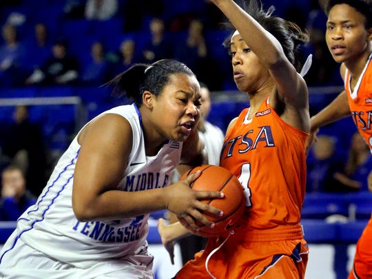 MTSU's China Dow pushes her way to the basket as Dow is defended by UTSA's Crystal Chidomere as Tesha Smith comes up from the back during the game on Thursday Jan. 29, 2015.