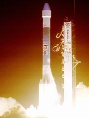 A Delta rocket lifts off carrying NASA's Mars Pathfinder