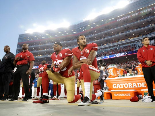 San Francisco 49ers safety Eric Reid (35) and quarterback Colin Kaepernick (7) kneel during the national anthem before a game against the Los Angeles Rams in Santa Clara, Calif., on Sept. 12, 2016. What began more than a year ago with a lone NFL quarterback protesting police brutality against minorities by kneeling silently during the national anthem before games has grown into a roar, with hundreds of players sitting, kneeling, locking arms or remaining in locker rooms, their reasons for demonstrating as varied as their methods.