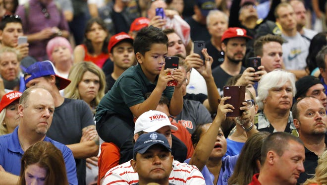 People clamor to see presidential candidate Donald Trump at the Phoenix Convention Center Wednesday, Aug. 31, 2016 in Phoenix, Ariz.