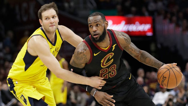 Cleveland Cavaliers' LeBron James (23) drives past Indiana Pacers' Bojan Bogdanovic (44), from Croatia, in the first half of Game 5 of an NBA basketball first-round playoff series, Wednesday, April 25, 2018, in Cleveland. (