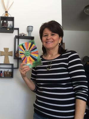 Sheboygan resident Cristi Winkler penned a book about her experience being touched by God on the game show Wheel of Fortune.