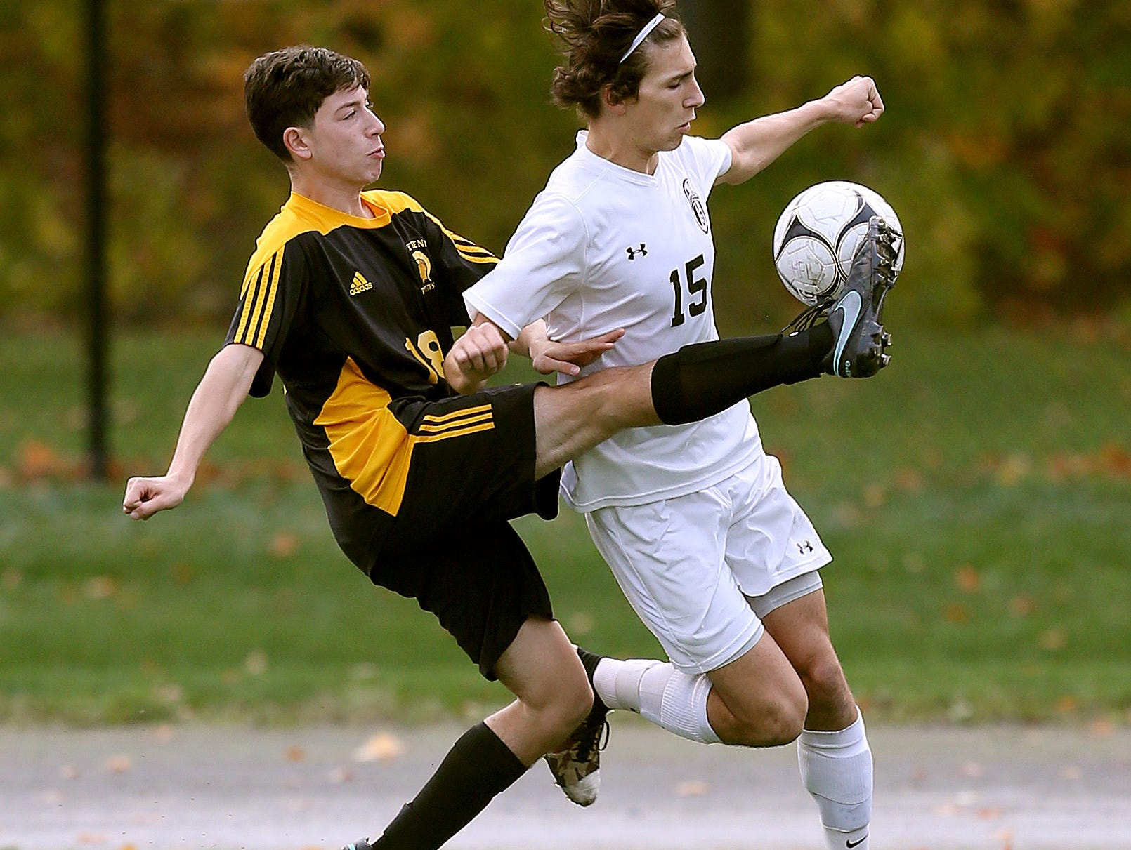 Athena's Bryan Testa (18) tries to play the ball around HFL's Kieran Papalia.