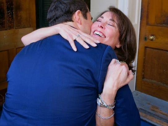 Dr. Rhett Kent hugs his mom immediately after he arrived