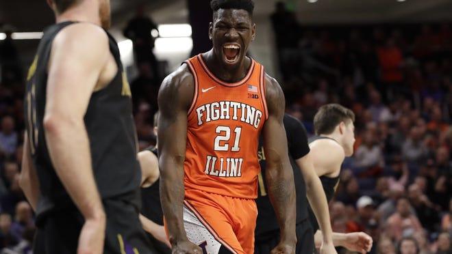 Illinois big man Kofi Cockburn celebrates during a game last season. The Big Ten Freshman of the Year decided to forgo the NBA draft and return to play for the Illini.