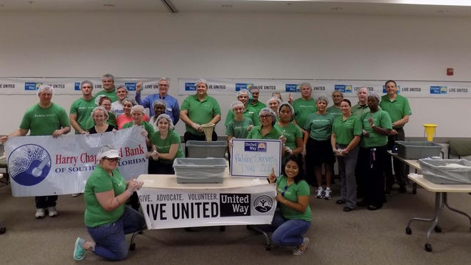 Publix employees packing meals for Harry Chapin Food Bank.