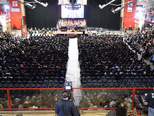 Graduates and their family members fill Halenbeck Hall