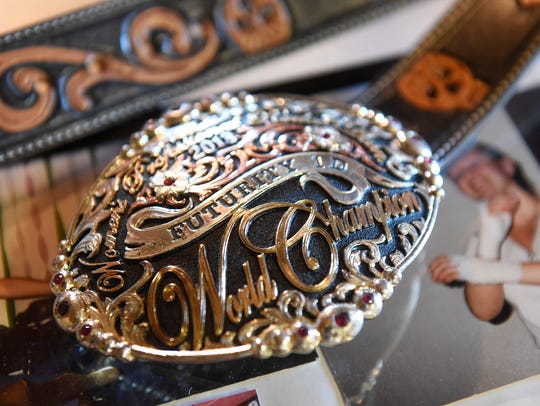 A rodeo buckle won by Lacey Kuschel at the family's