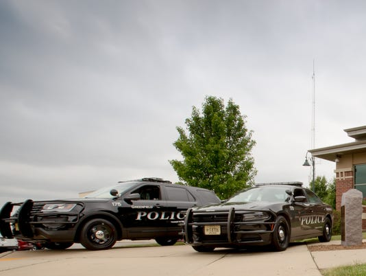 Greenfield police squads in front of the Greenfield Law Enforcement Center