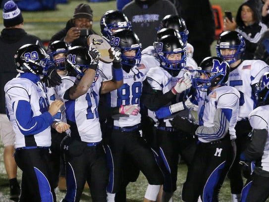Millbrook players celebrate their 42-20 victory over