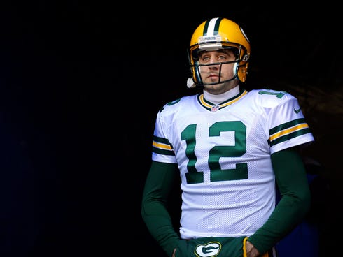 Aaron Rodgers returned to action Sunday and went  25-for-39 passing for 318 yards with two touchdowns and two interceptions.