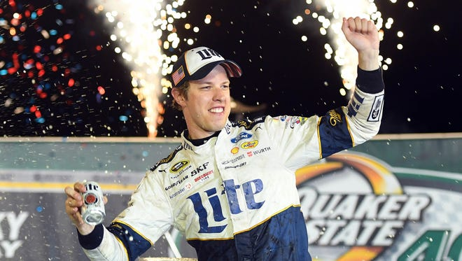 Jul 9, 2016; Sparta, KY, USA; NASCAR Sprint Cup Series driver Brad Keselowski celebrates after winning the Quaker State 400 presented by Advance Auto Parts at Kentucky Speedway.