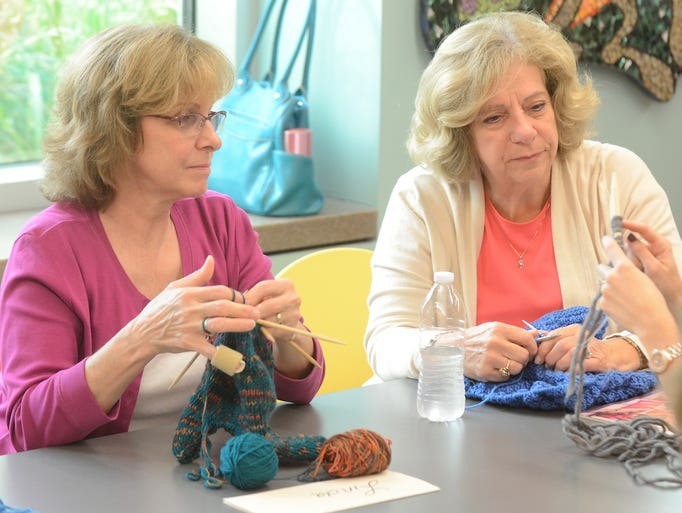Knitters Linda Potts, left, and Donna Osborne work on some projects during an Oct. 4 meeting of the Knitting Together group at the Novi Public Library. The group meets every Thursday in the downstairs crafts room at 10 a.m. and welcomes all knitters from beginner to expert.