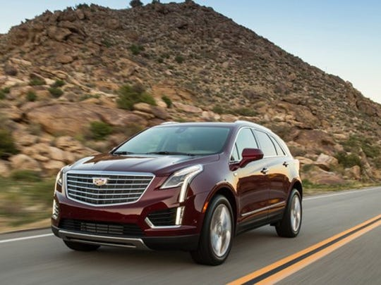 A dark red Cadillac XT5 crossover SUV.