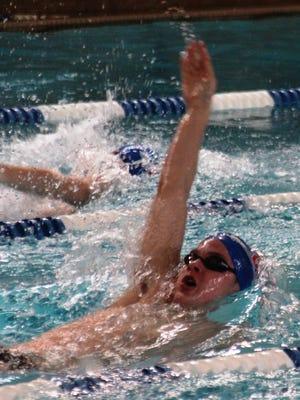 Brendan Meyer of Covington Catholic swims the backstroke.