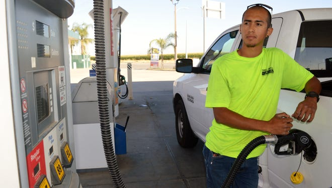 Octavio Escott makes a stop  to fill up for gas at Stanley's on Cartmill Avenue in Tulare before starting his work day.