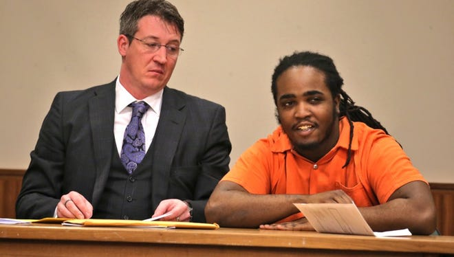 Lydell Strickland smiles after he was sentenced to 155 years to life in prison.