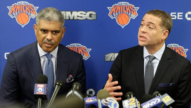 New York Knicks' general manager Scott Perry, right, and president Steve Mills speak to reporters at an NBA basketball news conference in Tarrytown, N.Y., Thursday, April 12, 2018. The Knicks fired coach Jeff Hornacek early Thursday, making the decision shortly after beating Cleveland on Wednesday night to finish a 29-53 season.