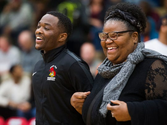 Deidre Marsh walks her son Josh Marsh, a senior basketball