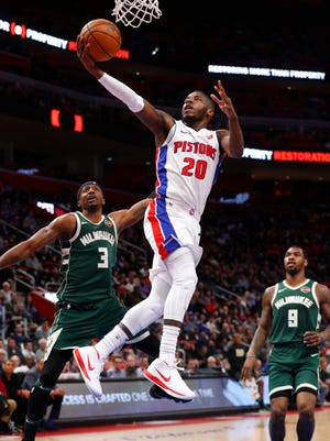 Pistons guard Dwight Buycks drives past Bucks guard Jason Terry in the first half at LCA on Wednesday.