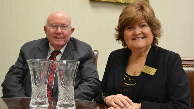 Dr. Tommy King, president of William Carey University, and Dr. Janet Williams, Carey's dean of nursing, pose with crystal awards received during the Mississippi Nurses' Association's annual Nightingale Awards Gala in Jackson on March 2. During the ceremony, Carey's Fail School of Nursing was named the School of Nursing of the Year and Dr. Williams was named School of Nursing Administrator of the Year.