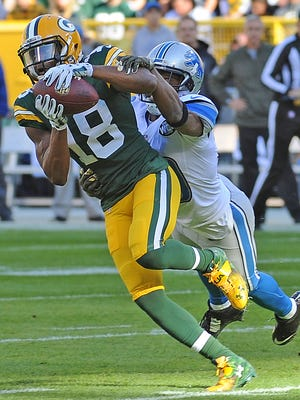 Green Bay Packers wide receiver Randall Cobb makes a catch over the middle during last Sunday's game against the Detroit Lions at Lambeau Field.