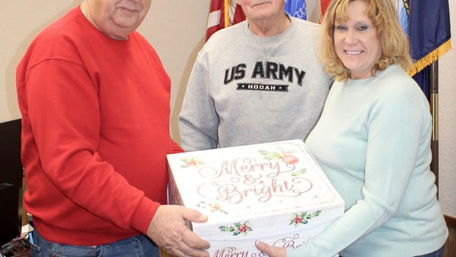 Discussing next year's Troop Christmas project are Richard Deller, Larry Rathburn and Renae Shircliff.