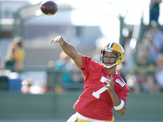 Packers quarterback Brett Hundley throws during training