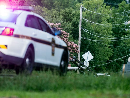 A utility pole is seen in the distance at the scene