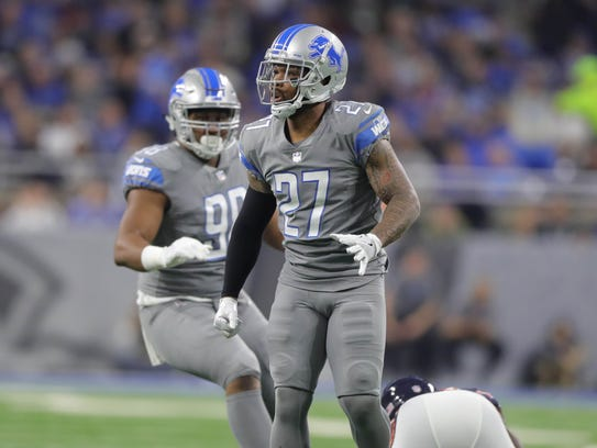 Lions safety Glover Quin celebrates his tackle on Bears