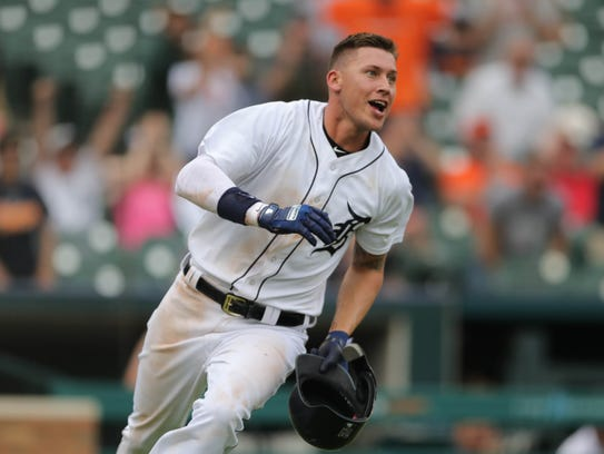 JaCoby Jones scores the winning run against Tampa Bay during the 12th inning May 2 at Comerica Park.