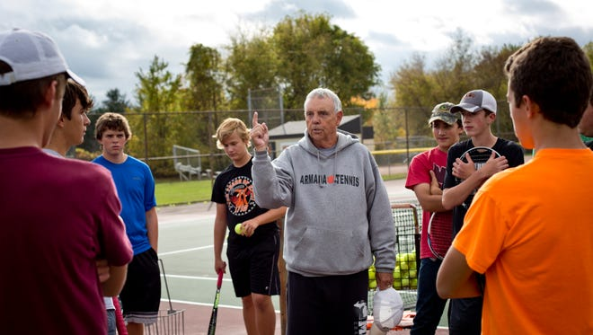 Coach Dave Fredette talks with players during tennis practice Tuesday, October 13, 2015 at Armada High School. Fredette has coached the Armada High School boys tennis team for 50 years.