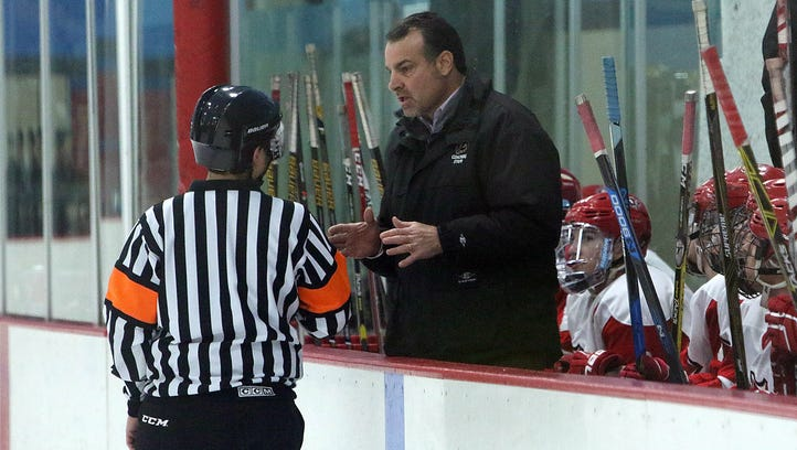 Arrowhead coach Carl Valimont discusses a penalty call with a referee during a game at the Mullet Ice Arena in Hartland Tuesday, Jan. 31, 2017.