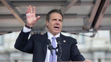 Gov. Andrew Cuomo speaks during a rally to raise the minimum wage at the Empire State Plaza on Tuesday, March 15, 2016.