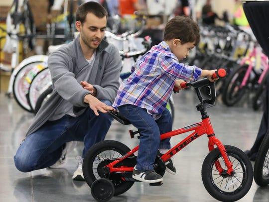 Jose Gonzalez of Greenfield helps his son, Dan Gonzalez,