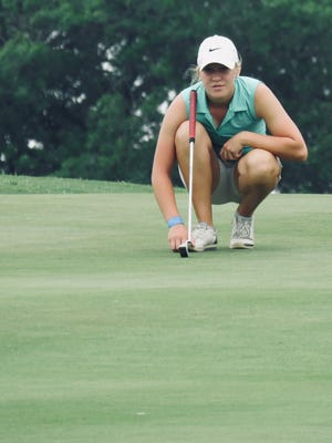 Christoval High School's Taylor Tomlinson lines up a putt last spring. The senior is the defending Class 2A girls state champion. She signed a letter of intent on Thursday, Nov. 9, 2017, to play golf for Angelo State University.