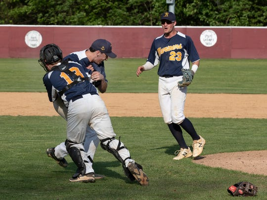 Toms River North's Jonathan Giordano gets tackled by