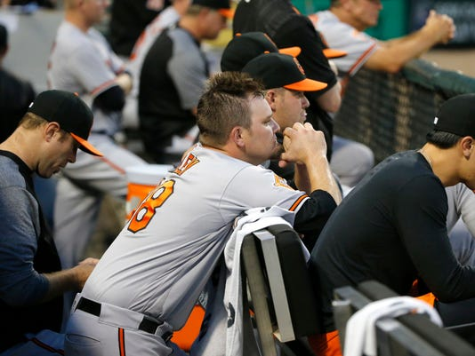 Baltimore Orioles starting pitcher Wade Miley watches from the dugout after being pulled from the game during the third inning of a baseball game against the Chicago White Sox Monday, June 12, 2017, in Chicago. (AP Photo/Charles Rex Arbogast)
