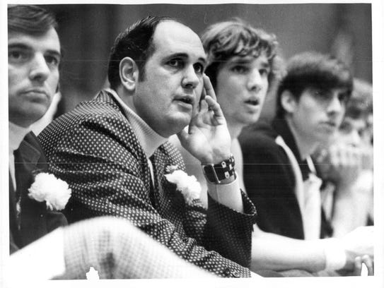 Paul Mueller, middle, coached boys varsity basketball