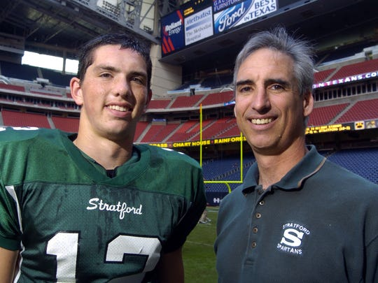 Ex-Houston Oiler backup quarterback Oliver Luck, is shown with his son, Andrew Luck, quarterback for Stratford High School, before a playoff game against Cypress Falls at Reliant Stadium, on Nov. 25, 2006. Andrew went on to become quarterback of the Indianapolis Colts and his father is now the No. 2 man at the NCAA.
