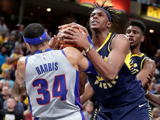 Indiana Pacers center Myles Turner, front right, and Detroit Pistons forward Tobias Harris (34) vie for a jump ball in the final minute of the second half of an NBA basketball game in Indianapolis, Friday, Dec. 15, 2017. (AP Photo/Michael Conroy)