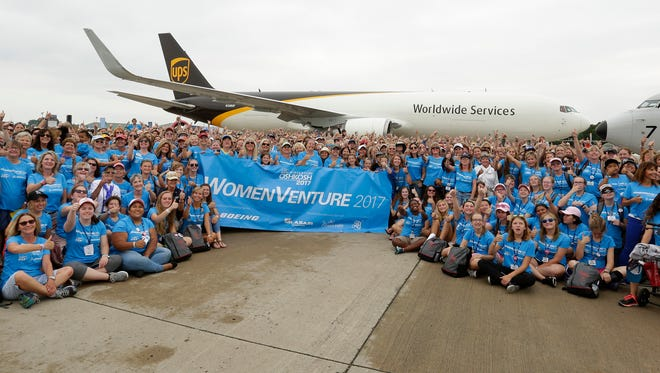 It was all thumbs up for WomenVenture during their photo shoot in front of the UPS Freight Jet the 767-300 at Boeing Plaza Wednesday July 26, 2017, in Oshkosh, Wis.  The 65th annual Experimental Aircraft Association Fly-In Convention draws over 500,000 people annually to the area.  The convention runs through July 30.Joe Sienkiewicz / USA TODAY NETWORK-Wisconsin