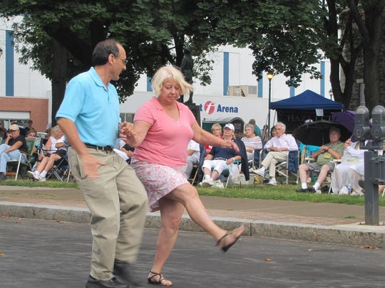A couple take to North Main Street Saturday to dance to the Fredtown Stompers of Buffalo, one of four groups featured in the 10th annual Twin Tiers Michelob Jazz Festival in downtown Elmira.